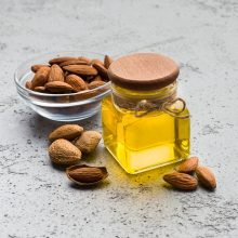 Almond oil and bowl with almonds